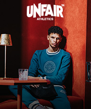 Model wears sporty and casual apparel from the Unfair Athletics Inner Circle collection